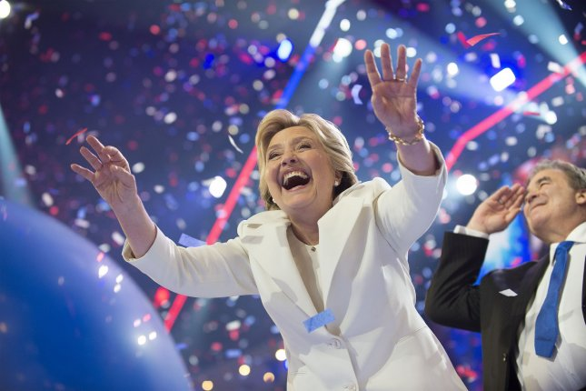 Hillary Clinton reaches out for balloons after her acceptance speech during the Democratic National Convention at Wells Fargo Center in Philadelphia on July 28, 2016. File Photo by Pete Marovich/UPI