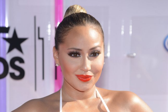 Recording artist Adrienne Bailon attends the 14th annual BET Awards at Nokia Theatre L.A. Live in Los Angeles on June 29, 2014. The award show spotlights the 50th anniversary of the Civil Rights Bill and its impact on America. UPI/Phil McCarten