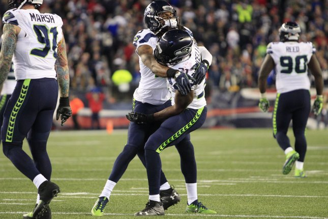 Seattle Seahawks corner back Richard Sherman (25) gives a hug to safety Kam Chancellor (21) after Chancellor broke up an end zone pass intended for New England Patriots tight end Rob Gronkowski (not pictured) in the fourth quarter at Gillette Stadium in Foxborough, Massachusetts on November 13, 2016. File photo by Matthew Healey/UPI