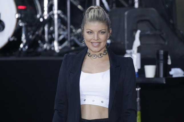 Fergie spent her birthday with 4-year-old son Axl Jack. File Photo by John Angelillo/UPI
