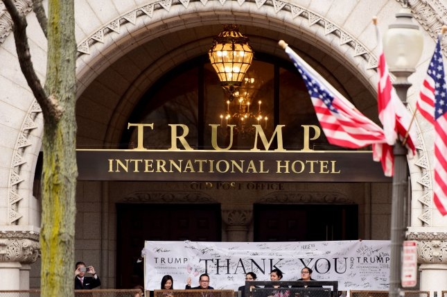 Trump International Hotel employees show their support at the inauguration ceremony at the Capitol on January 20, 2017 in Washington, D.C. On Friday, a federal judge denied Trump's request for a stay in a case that alleges he did business with foreign governments, a violation of the emoluments clause of the U.S. Constitution. Photo by Michael Wiser/UPI