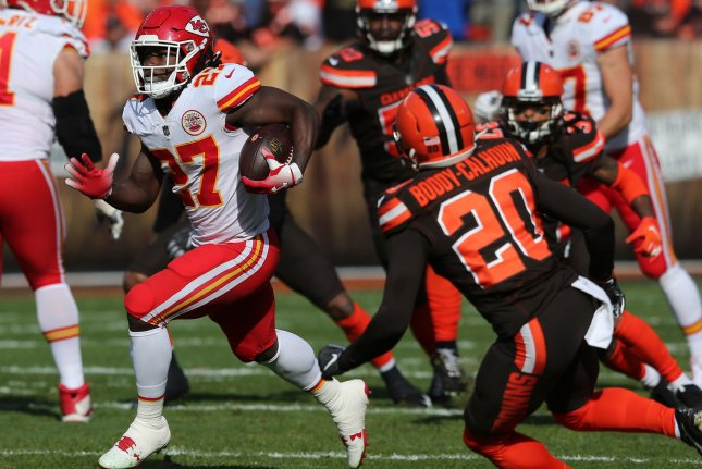 76233812d71 Kansas City Chiefs running back Kareem Hunt runs through the Cleveland  Browns defense in the first half on November 4 at First Energy Stadium in  Cleveland.