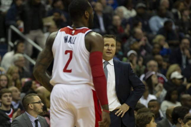 Washington Wizards head coach Scott Brooks talks to Washington Wizards guard John Wall (2) during the fourth quarter at Capital One Arena in Washington, D.C. Photo by Alex Edelman/UPI