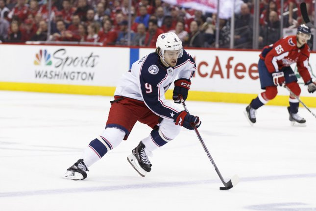 Columbus Blue Jackets forward Artemi Panarin (9) carries the puck up the ice against the Washington Capitals on April 12 at Capital One Arena in Washington, D.C. Panarin was offered vodka for life by a Columbus-based distillery to stay with the team. Photo by Alex Edelman/UPI