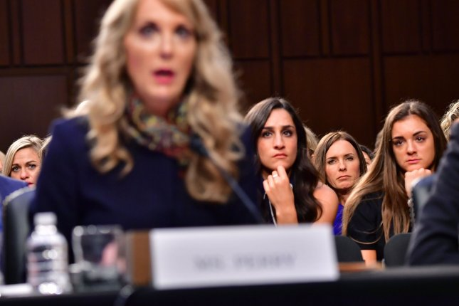 Victims of sexual abuser and former Team USA doctor Larry Nassar listen at a Senate hearing as USA Gynmastics President Kerry Perry, left, testifies on Capitol Hill on July 24, 2018. File Photo by Kevin Dietsch/UPI