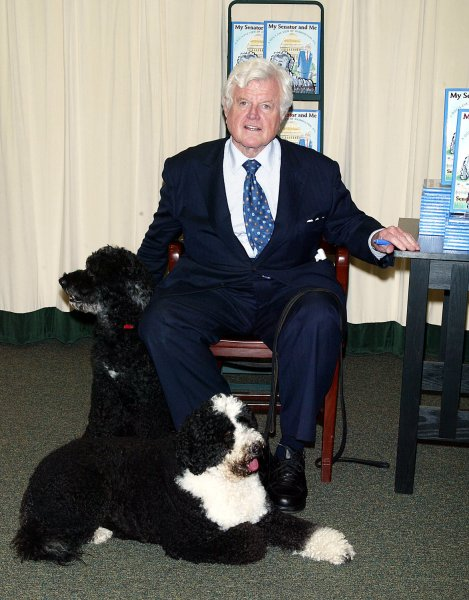 Senator Ted Kennedy, with his dogs Sunny (front) and Splash, after signing copies of his new book My Senator and Me: A Dog's-Eye View of Washington D.C. at Barnes & Noble in New York on June 16, 2006. (UPI Photo/Laura Cavanaugh)