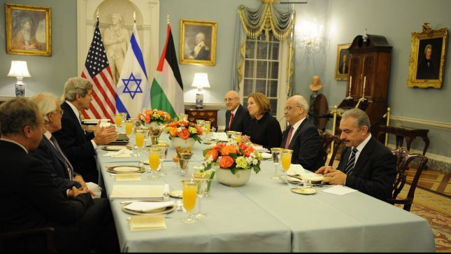 US Secretary of State John Kerry (L) welcomes Israeli and Palestinian delegations for a dinner prior to the opening of peace talks, at the State Department, July 29,, 2013, in Washington, DC. Across the table from Kerry (L-R) Israel's Yitzhak Molcho, Israeli Justice Minbister Tzipi Livni, Palestinian Chief Negotiator Saeb Erekat and Mohammad Shtayyeh. Kerry hopes to restart the moribund peace talks after three years of inactivity. UPI/Mike Theiler