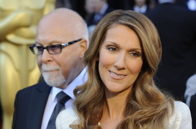 Rene Angelil (L) inspired wife Celine Dion's upcoming return to the stage. File photo by Phil McCarten/UPI