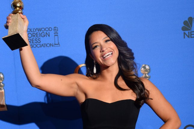 Gina Rodriguez appears backstage with the award she won for her role in Jane the Virgin during the 72nd annual Golden Globe Awards in Beverly Hills on January 11, 2015. The series is one of seven The CW renewed this weekend for the 2017-18 season. File Photo by Jim Ruymen/UPI