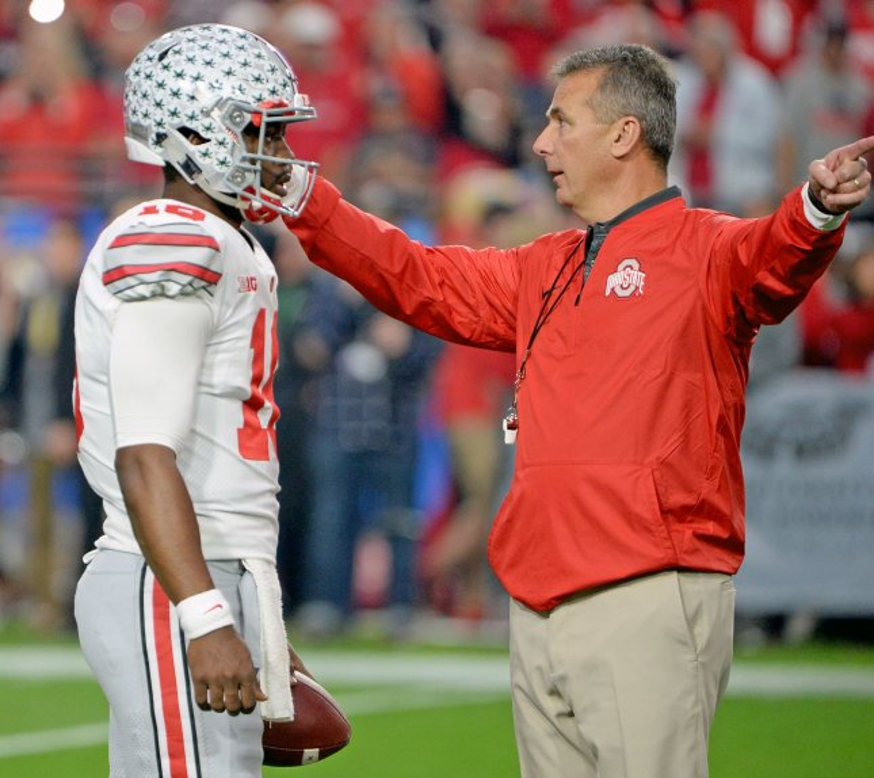 Ohio State Buckeyes coach Urban Meyer talks to quarterback J.T. Barrett prior to a recent game. Photo by Art Foxall/UPI