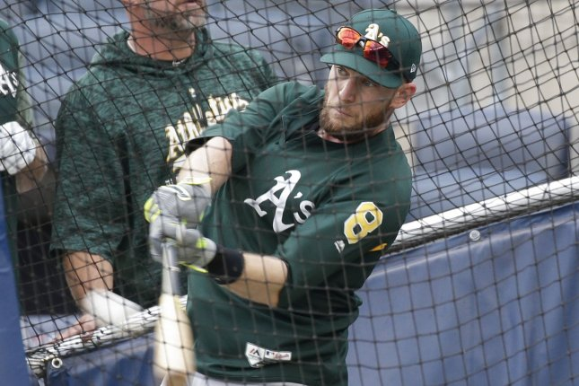 Former Oakland Athletics infielder Jed Lowrie takes batting practice one day before facing the New York Yankees in the MLB American League wild card game on October 2 at Yankee Stadium in New York City. Photo by John Angelillo/UPI