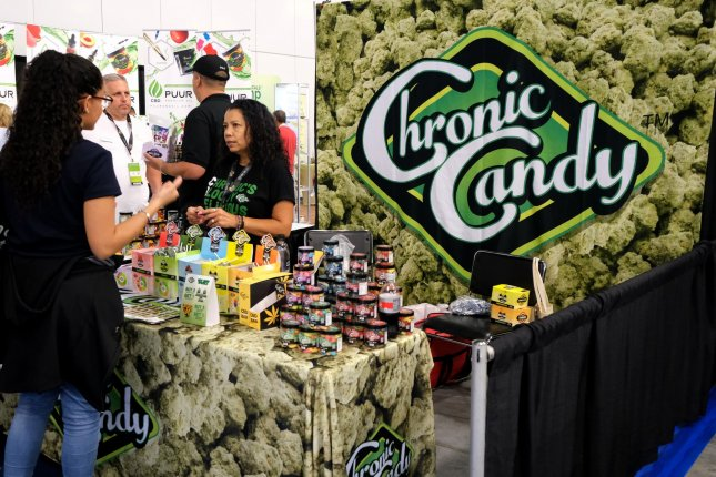 Exhibitors display CBD products on August 3 at an exposition at the Miami Beach Convention Center in Miami Beach, Fla. Photo by Gary I Rothstein/UPI
