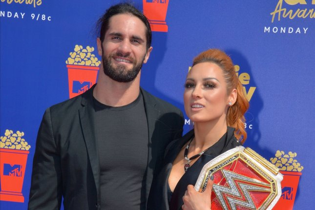 WWE stars Seth Rollins (R) and Becky Lynch arrive for MTV Movie & TV Awards on June 2019. WWE has launched a free version of the WWE Network streaming service. File Photo by Jim Ruymen/UPI