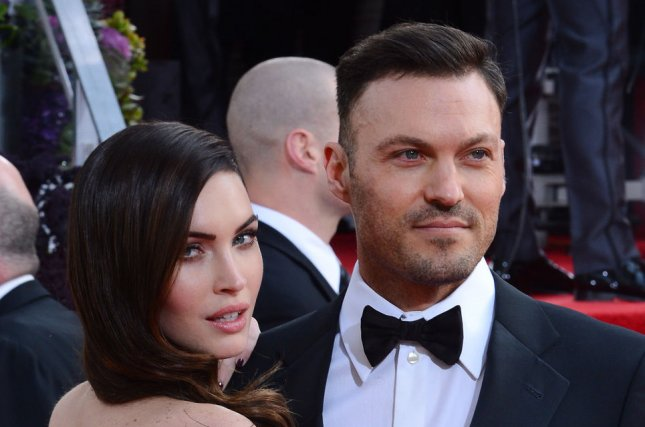Megan Fox (L) and husband Brian Austin Green at the Golden Globe Awards on January 13, 2013. The couple married in 2010. File Photo by Jim Ruymen/UPI