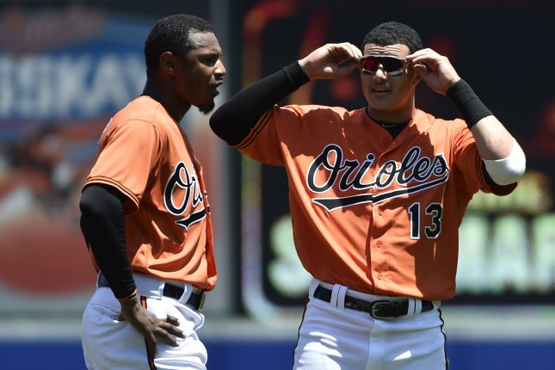 Baltimore Orioles shortstop Manny Machado (13) talks to center fielder Adam Jones (L). Photo by David Tulis/UPI