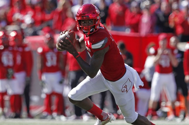 Louisville Cardinals quarterback Lamar Jackson (8) throws under pressure from NC State's defense during the second half of play at Papa John's Cardinal Stadium October 22, 2016 at Churchill Downs in Louisville Kentucky. Photo by John Sommers II /UPI