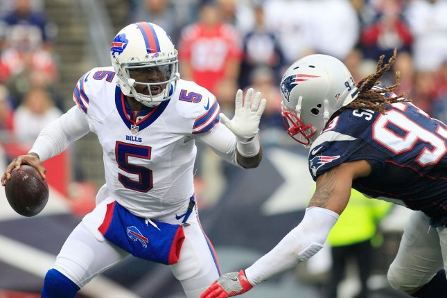 Buffalo Bills quarterback Tyrod Taylor (5) dodges a sack by New England Patriots defensive lineman Jabaal Sheard (93) in the fourth quarter at Gillette Stadium in Foxborough, Massachusetts on October 2, 2016. The Bills defeated the Patriots 16-0. Photo by Matthew Healey/ UPI