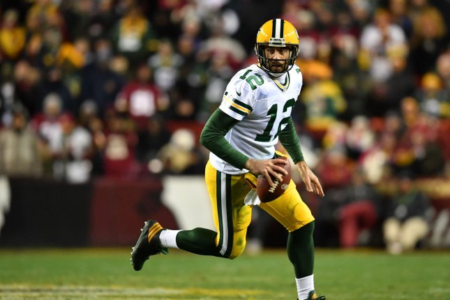 Green Bay Packers quarterback Aaron Rodgers (12) scrambles against the Washington Redskins in the second quarter at FedEx Field in Landover, Maryland on November 20, 2016.