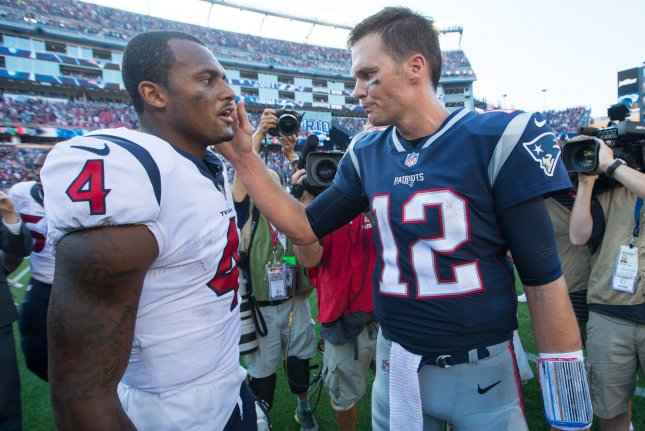 New England Patriots quarterback Tom Brady (12) gives Houston Texans quarterback Deshaun Watson (4) a pat on the cheek after their game at Gillette Stadium in Foxborough, Massachusetts on September 24, 2017. File photo by Matthew Healey/UPI