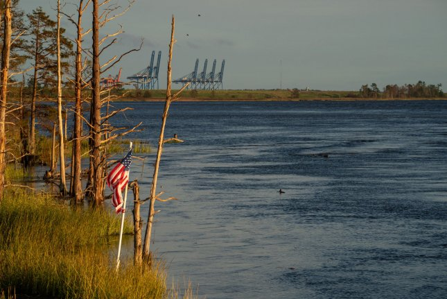 Water on North Carolina's Cape Fear River overwhelmed a Duke Energy cooling lake and adjacent coal ash dumps, causing a breach in a dam, the company said. Photo by Ken Cedeno/UPI