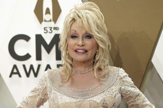 Dolly Parton arrives for the 52nd Annual Country Music Association Awards at Bridgestone Arena in Nashville on November 13, 2019. The singer turns 75 on January 19. File Photo by John Angelillo/UPI