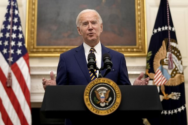 President Joe Biden delivers remarks Friday on his administration's response to the economic crisis and signs executive orders in the State Dining Room of the White House in Washington, D.C. Photo by Ken Cedeno/UPI