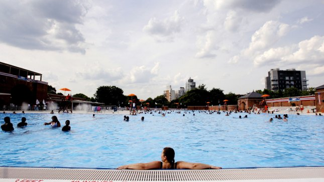 People get relief from the heat be swimming in McCarren Park Pool a few days after its reopening in Williamsburg, New York on July 3, 2012. UPI/John Angelillo