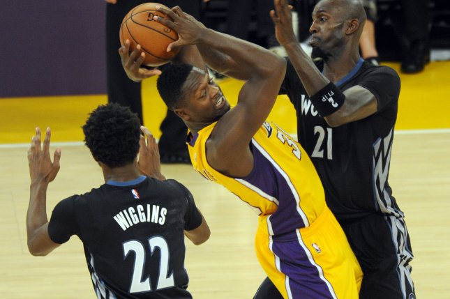 Minnesota Timberwolves Kevin Garnett, right, stops Los Angeles Lakers' Julius Randle in the first half at Staples Center in Los Angeles on October 28, 2015. The Timberwolves defeated the Lakers 112-111. Photo by Lori Shepler/UPI