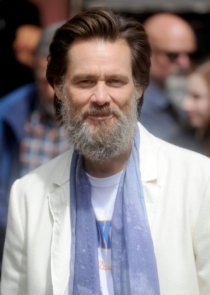 Jim Carrey arrives at the backstage entrance before the final taping of the Late Show, with David Letterman in 2015. Carrey is switching things up a bit, taking on a starring role and executive producing a horror flick, Aleister Arcane. File Photo by Dennis Van Tine/UPI