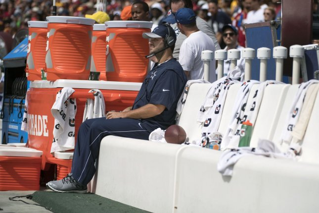 Dallas Cowboys Tony Romo sits on the bench during the Cowboy's game against the Washington Redskins at FedEx Field in Landover, Maryland on September 18, 2016. Romo is sidelined with a back injury. Photo by Kevin Dietsch/UPI