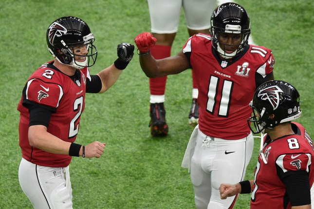 Atlanta Falcons quarterback Matt Ryan (2) fist bumps receiver Julio Jones (11) with backup quarterback Matt Schaub alongside during warmups prior to playing the New England Patriots at Super Bowl LI on February 5 at NRG Stadium in Houston, Texas. File photo by David Tulis/UPI