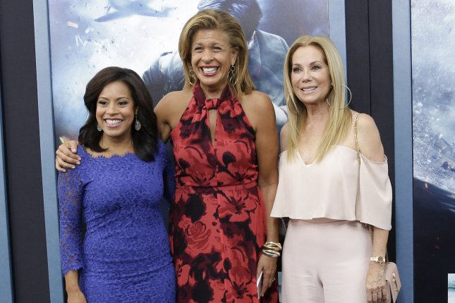 Hoda Kotb (C), pictured here with Chanel Jones (L) and Kathie Lee Gifford, dressed up as Blake Shelton on Halloween. File Photo by John Angelillo/UPI