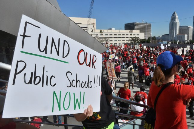 Hours after Los Angeles educators (pictured) reached an agreement Tuesday to end a six-day strike, teachers in Denver voted to strike for an increase in pay. Photo by Jim Ruymen/UPI