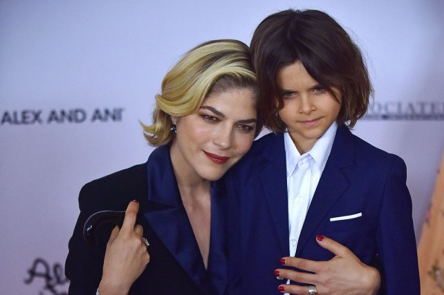 Selma Blair (L), pictured with son Arthur, discussed how the 7-year-old is coping with her multiple sclerosis diagnosis. File Photo by Christine Chew/UPI