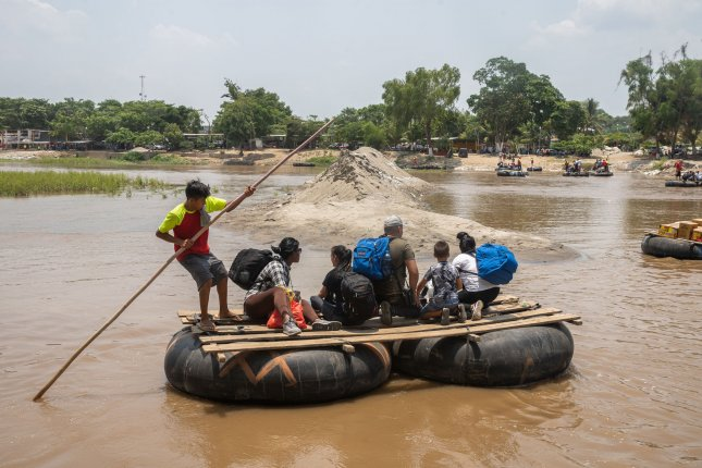 Migrants leave Ciudad Hidalgo, Mexico, by taking a raft on the Suchiate River to Tecun Uman, Guatemala on May 9, 2019. Photo by Ariana Drehsler/UPI