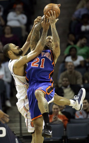 Tyson Chandler, left, then with the Charlotte Bobcats, and New York Knicks forward Wilson Chandler battle for a rebound in Charlotte, N.C., Dec. 15, 2009. UPI/Nell Redmond