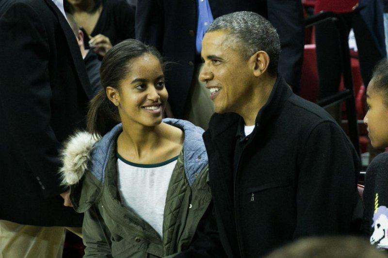 President Barack Obama with his eldest daughter, Malia. File Photo by Drew Angerer/UPI/Pool