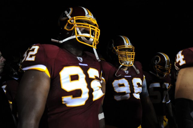 Washington Redskins' Albert Haynesworth (R) and other members of the Redskins wait to take the field prior to the Redskins game against the Dallas Cowboys at FedEx Field in Landover, Maryland on September 12, 2010. UPI/Kevin Dietsch