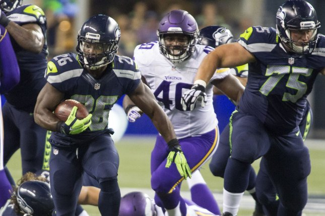 Seattle Seahawks running back Troymaine Pope (26) runs for a 26-yard gain against the Minnesota Vikings during the fourth quarter of a preseason game at CenturyLink Field in Seattle, Washington on August 18, 2016. The Vikings beat the Seahawks 18-11. Photo by Jim Bryant/UPI