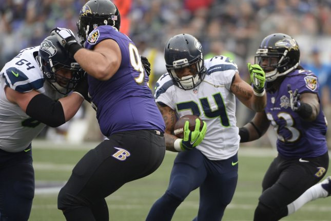 Seattle Seahawks running back Thomas Rawls (34) rushes for short yardage against the Baltimore Ravens during the first half of their NFL game at M&T Bank Stadium in Baltimore, Maryland, December 13, 2015. Photo by David Tulis/UPI