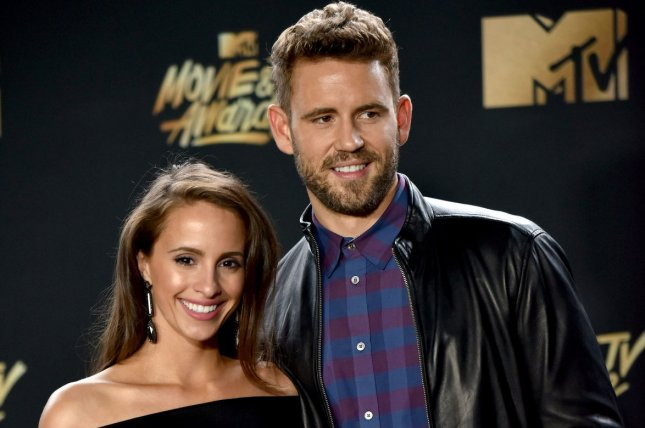 Nick Viall (R) and Vanessa Grimaldi attend the MTV Movie & TV Awards on May 7. The couple shared photos from a wedding Saturday following reports they have called off their engagement. File Photo by Christine Chew/UPI