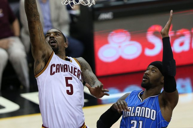 Orlando Magic star Terrence Ross (R) had a game-high 21 points, including an acrobatic fourth quarter dunk, in a win against the Charlotte Hornets on Thursday in Orlando. File Photo by Aaron Josefczyk/UPI