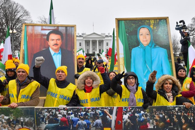 Demonstrations hold portraits of Iranian politicians Massoud Rajavii and his wife, Maryam Rajavi, at a rally help by the Organization of Iranian-American Communities in support of a regime change in Iran, in Washington, D.C., on March 8. File Photo by Kevin Dietsch/UPI