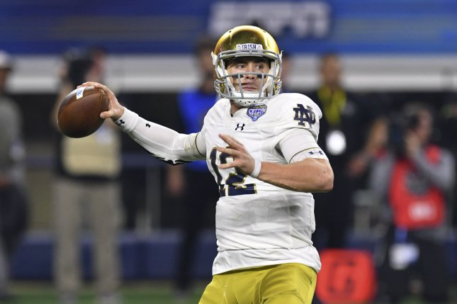 Fighting Irish quarterback Ian Book (12) has led the team to a 7-2 record entering a game against Navy on Saturday at Notre Dame Stadium in Indiana. Photo by Shane Roper/UPI