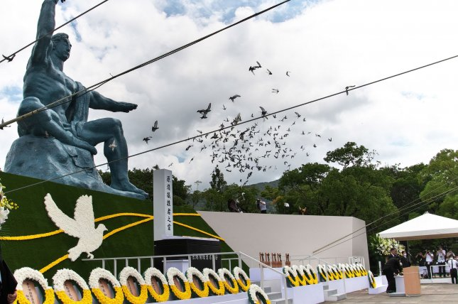 Released doves fly during the ceremony for the atomic bomb victims marking the 75th anniversary of the atomic bombing of Nagasaki at the Peace Park. Photo by Kezio Mori/UPI
