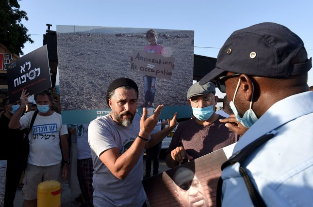Palestinians and Israelis protest against Israel's plan to annex parts of the West Bank at the Almog Junction near Jericho in the West Bank on June 27. The Palestinian Authority sent a letter to the United Nations over concerns of new settlements in the West Bank. Photo by Debbie Hill/UPI
