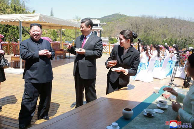 North Korean leader Kim Jong Un (L) offered a message of sympathy to China's Xi Jinping (C-R) in the aftermath of floods in Henan Province, according to reports. File Photo by KCNA/UPI