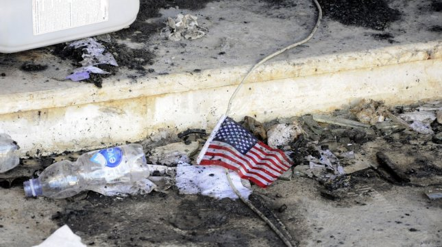 A small American flag is seen in the rubble at the United States consulate, one day after armed men stormed the compound and killed the U.S. Ambassador Christopher Stevens and three others in Benghazi, Libya on September 12, 2012. UPI/Tariq AL-hun