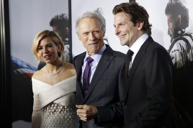 Sienna Miller, Clint Eastwood and Bradley Cooper arrive on the red carpet at the 'American Sniper' New York Premiere at Frederick P. Rose Hall, Jazz in New York City on December 15, 2014. UPI/John Angelillo