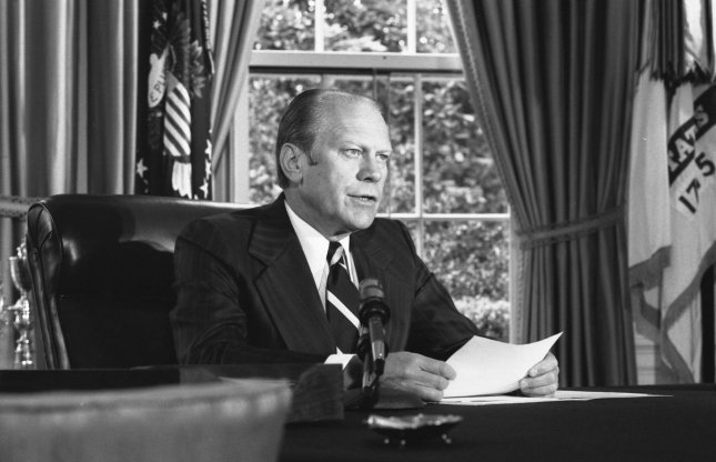 President Gerald Ford announces on Sept. 8, 1974, that he had pardoned former President Richard Nixon for any offenses he has committed or may have committed or taken part in during the Watergate scandal. Photo by David Hume Kennerly/Gerald R. Ford Library/UPI File